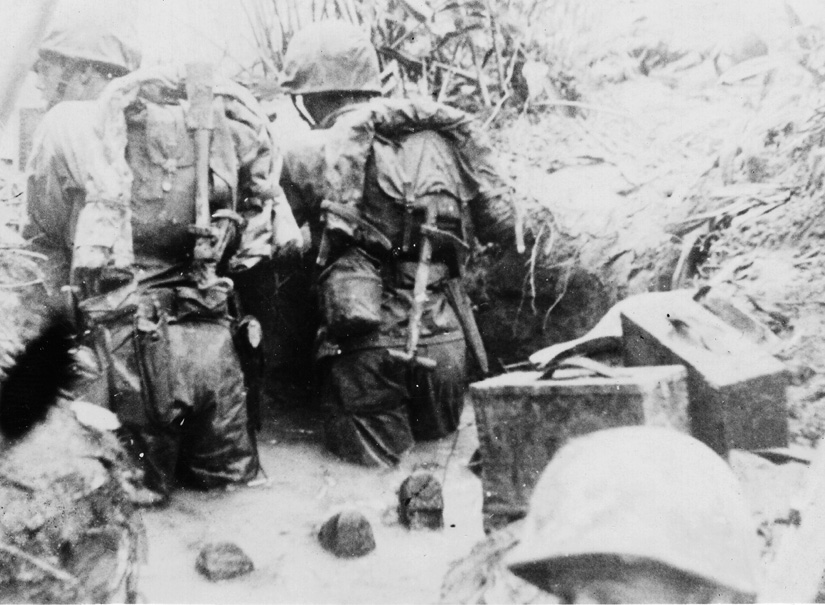And you wonder why they got Malaria . . . in foxholes, up to their shorts in rainwater.