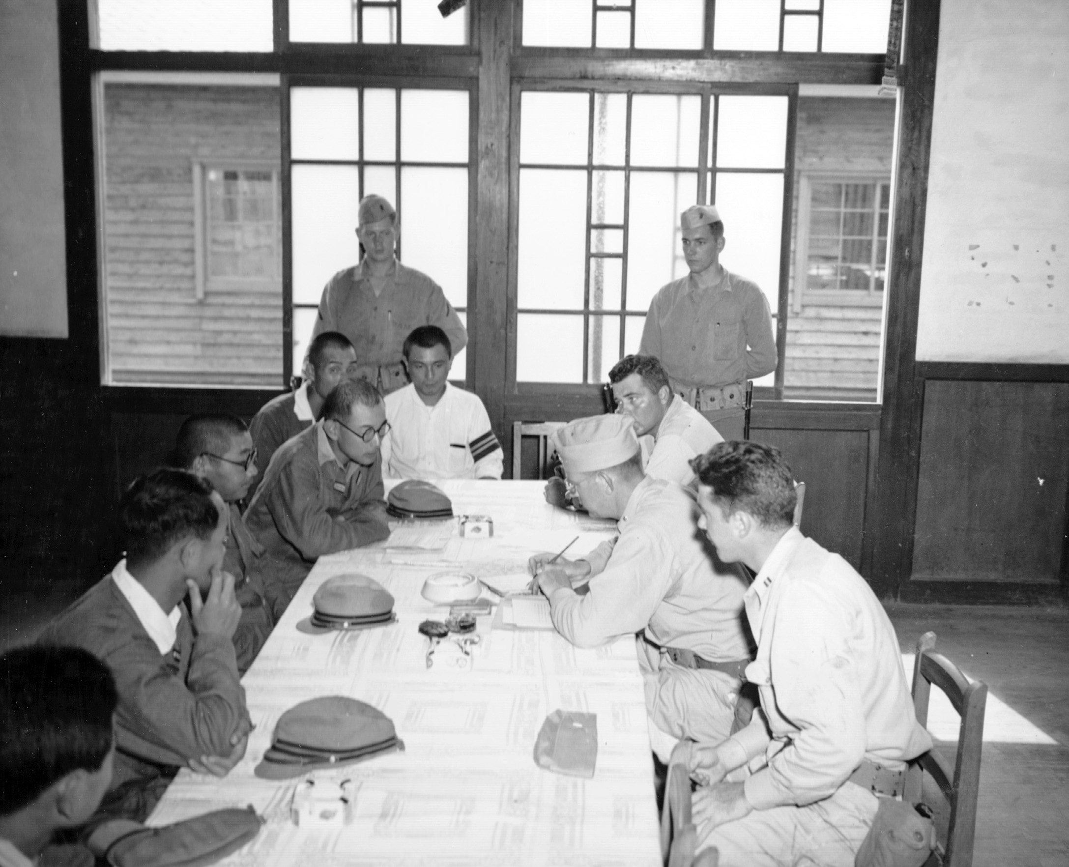 September 1945, Officers of the USS Boston accept surrender of Sasagama Chiba, Japan.  Norm Bayley (seated r)
